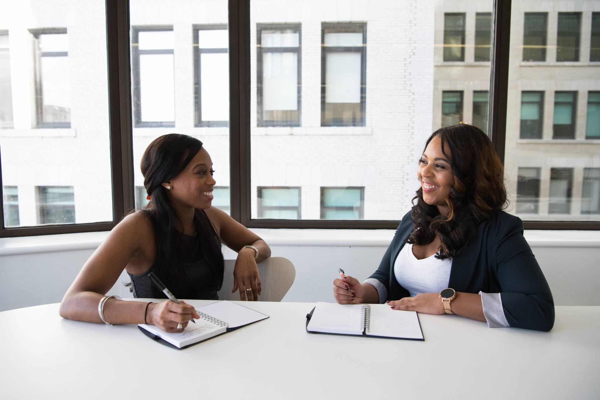 two black females from HR and organizational development talk
